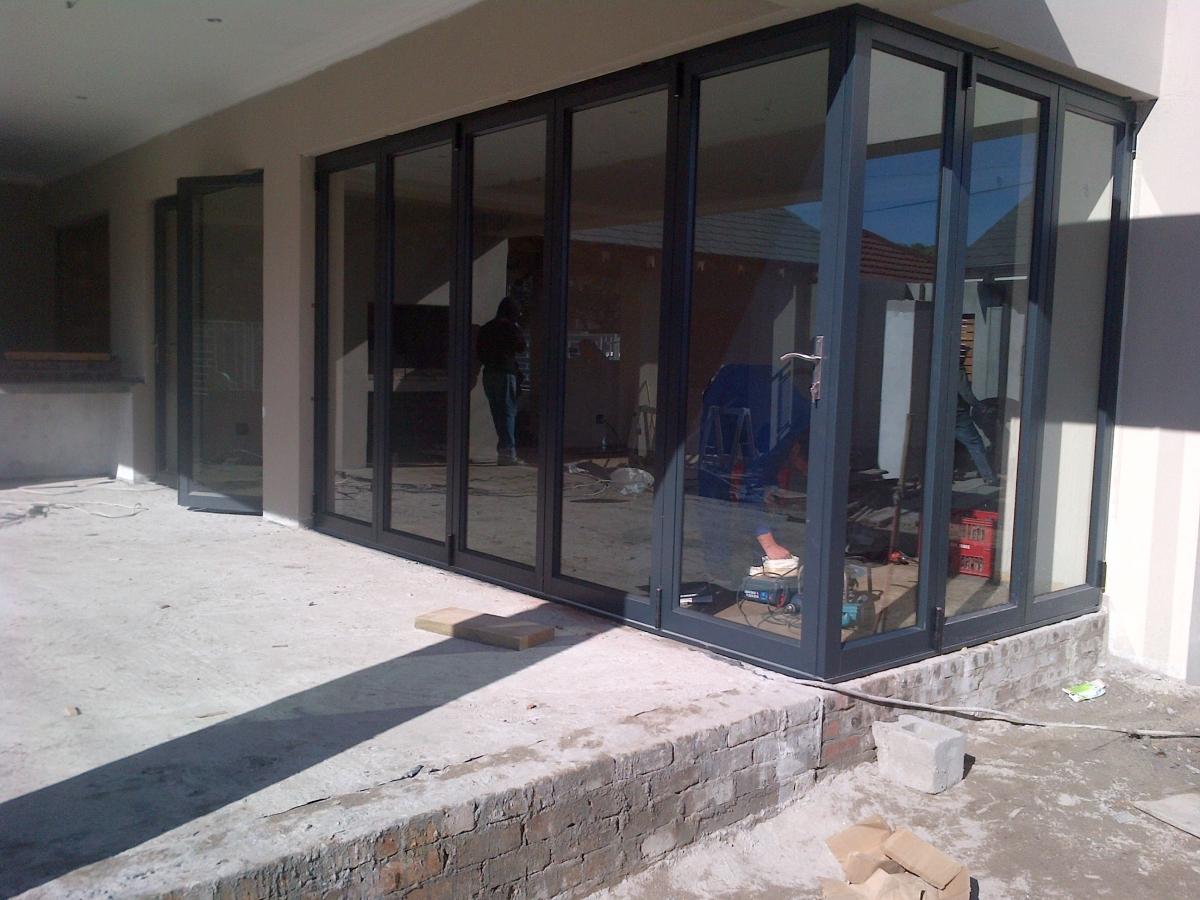 View some of our aluminium folding doors below & Aluminium Folding Doors in Cape Town | Supply and Fit - Hughes Aluminium